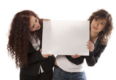 Young women holding billboard Royalty Free Stock Images
