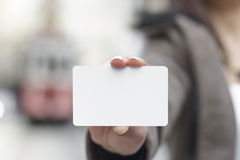 Young women holding a blank card in hands Stock Photography