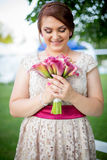 Young women holding the bouquet. Young woman holding the bouquet of orchide royalty free stock images