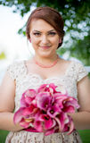 Young women holding the bouquet. Young woman holding the bouquet of orchide stock photography