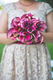 Young women holding the bouquet. Young woman holding the bouquet of orchide stock photos
