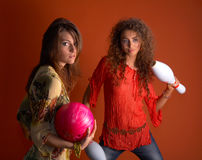 Young women holding bowling ball. In studio Stock Image