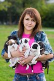 Young Women Holding Five Small Puppies Royalty Free Stock Photo
