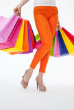Young women holding  multicolored shopping bags Stock Photo