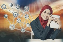 Young women holding tablet over abstract background and symbols Stock Photos