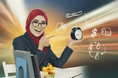 Young women holding vintage clock over abstract background and symbols. Time management concept. young woman holding vintage clock over abstract background and Stock Image