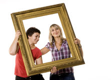 Young women holding wooden frame Royalty Free Stock Photo