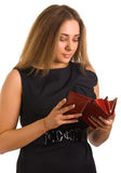 Young women holds a purse in hands Royalty Free Stock Photo