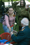 Young women honoring military man. Royalty Free Stock Photography
