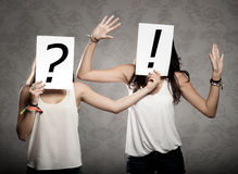 Young women with interrogation symbols Stock Photo