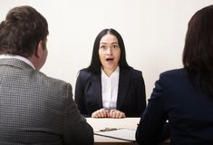 Young woman during job interview and members of managemen. royalty free stock image