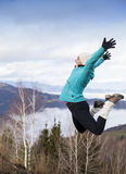 Young women joyfully jumping outdoors Stock Image