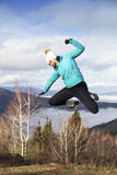 Young women joyfully jumping outdoors Royalty Free Stock Photos