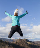 Young women joyfully jumping outdoors Royalty Free Stock Photo