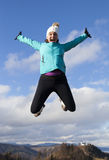 Young women joyfully jumping outdoors Royalty Free Stock Images