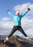 Young women joyfully jumping outdoors Stock Photo
