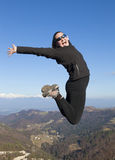 Young women joyfully jumping outdoors Royalty Free Stock Image