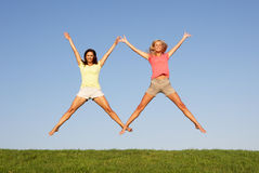 Young women jumping in air Royalty Free Stock Photography
