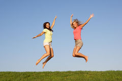 Young women jumping in air Stock Photography