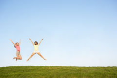 Young women jumping in air Stock Images