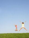 Young women jumping in air Royalty Free Stock Image