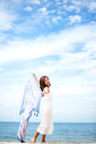 Young women jumping and happy on the beach. Travel and Vacatio Royalty Free Stock Images
