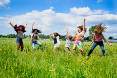 Young women jumping with joy Stock Photos