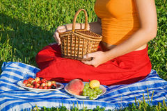 Young Women keeps in hand basket on glade Stock Photo
