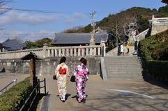 Young women in Kimono. Two young women in kimonos walk through the compounds of Kiyomizu-dera (Kiyomizu temple) in Kyoto, Kansai, Japan Stock Photos