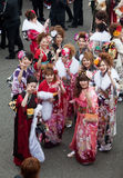 Young Women in kimono on Coming of Age Day. Kagoshima City, Japan, January 10, 2010. Young Japanese women in kimono flashing the peace sign for a photo on Coming stock photo