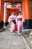 Young women in kimono dress. At Fushimi Inari Shrine in Kyoto Japan (during on new year eve). Photo taken on: April 03rd, 2014 Royalty Free Stock Images