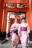 Young women in kimono dress. At Fushimi Inari Shrine in Kyoto Japan (during on new year eve Stock Images