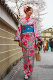 Young women in kimono dress. In Hanami-koji street, Gion district, in Kyoto Japan (during on new year eve). Photo taken on: April 03rd, 2013 Stock Photo