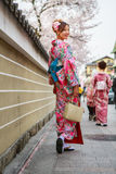 Young women in kimono dress. In Hanami-koji street, Gion district, in Kyoto Japan (during on new year eve). Photo taken on: April 03rd, 2013 Royalty Free Stock Photography