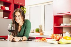 Young women in the kitchen. Pretty young woman in the kitchen Royalty Free Stock Photography