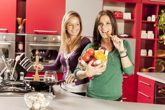 Young women in the kitchen. Pretty young women in the kitchen Stock Photo