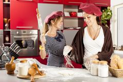 Young women in the kitchen. Young women preparing meal in the kitchen Royalty Free Stock Images