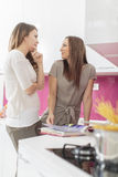 Young women in the kitchen. Two young women in the kitchen Royalty Free Stock Photography