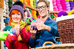 Young women in knitting fashion shop Stock Photography