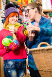 Young women in knitting fashion shop Royalty Free Stock Photography