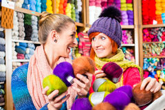 Young women in knitting shop. Young women buying colorful wool and yarn for their hobby in a knitting shop Stock Photography