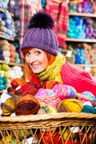 Young women in knitting shop Stock Images