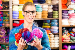 Young women in knitting shop Royalty Free Stock Photography