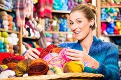 Young women in knitting shop Stock Photo