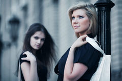 Two young fashion women with handbags Stock Images