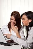 Young women in learning a program on the laptop Stock Images