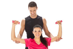 Woman with her personal fitness trainer exercising with weights Royalty Free Stock Photo
