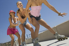 Young Women On In Line Skates Stock Image