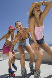 Young Women On In Line Skates Stock Images