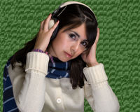 Young women listening music Royalty Free Stock Image